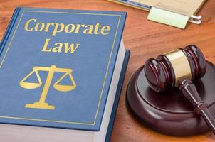 Law book with a gavel - Corporate law