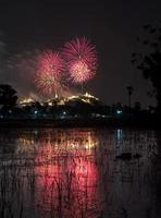 Multicolor fireworks night scene over the buddha temple, thailan photo