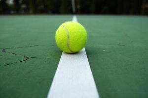 tennis ball on court photo