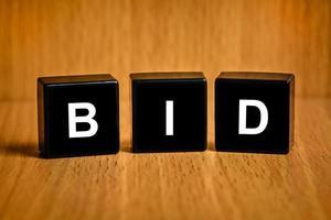 bid word on black block photo