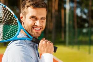 Confident tennis player. photo