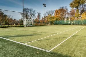 Tennis court in the autumn park