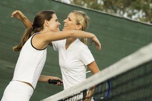 Tennis Players Hugging Each Other After Match photo