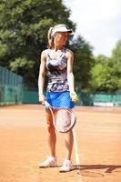 Woman playing tennis, Munich, Germany