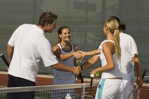 Tennis Players Shaking Hands at Net photo