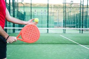 man playing paddle tennis photo
