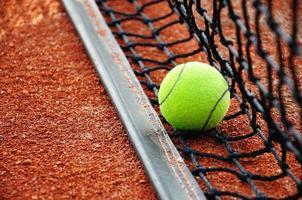 Tennisball on a tennis clay court