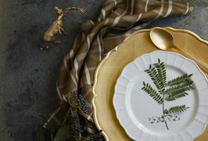 Holiday Gold place setting, napkin brown plaid, on grunge backgr