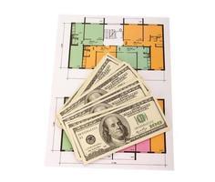 Hundred dollar bills money pile on blueprints