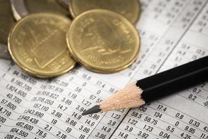 Business diagram on financial report with coins photo