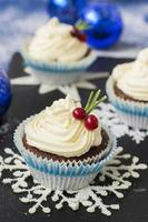 Chocolate cupcake with cream cheese in Christmas decorations