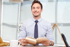Call center operator holding book photo
