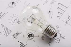 Light bulb with drawing graph photo