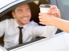 Pleasant businessman driving a car photo