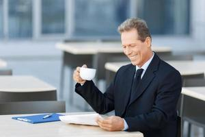 Handsome businessman sitting at the table photo