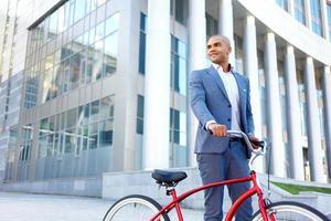 Nice man holding bicycle photo