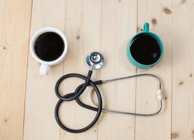 coffee cup and stethoscope, relaxing concept for doctor photo