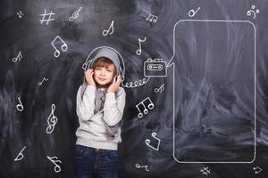 The boy listens to songs