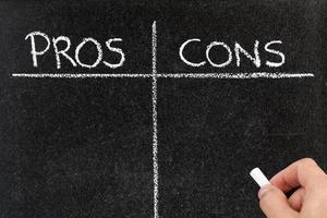 Pros and cons list on a blackboard