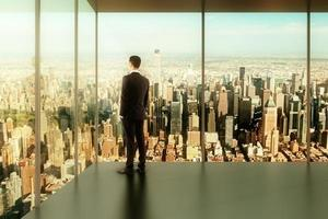 businessman in modern office with a view of the city photo