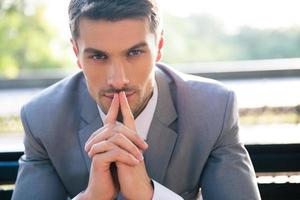 Portrait of a thoughtful businessman outdoors photo