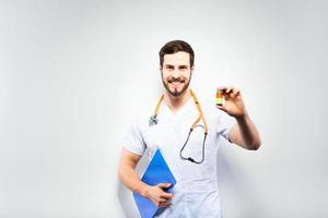 Handsome doctor showing pills photo