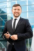 Portrait of well-dressed man on the contempopary background photo