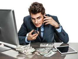 Successful businessman going to make a call by cell phone