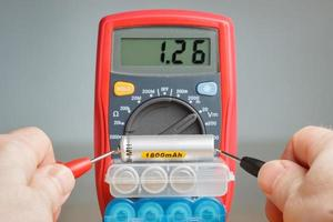 Measuring battery voltage with multimeter photo