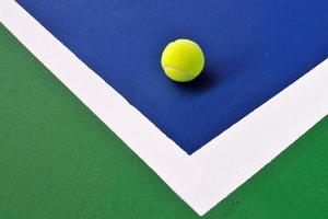 Tennis ball just on the court photo