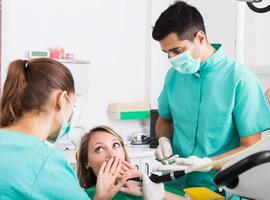 Terrified client in dental clinic photo