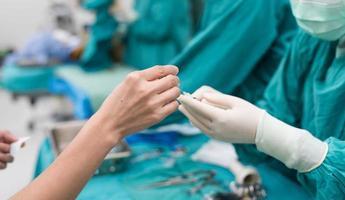 scrub nurse preparing medical solution photo