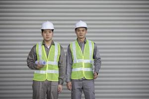 Two Asian industrial engineer's at work