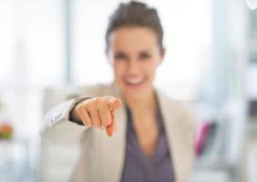 closeup on happy business woman pointing in camera