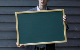 man holding a board