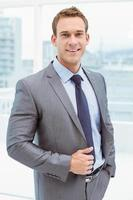 Smart businessman in suit at office photo