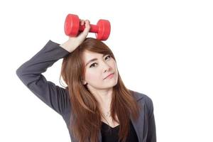 Asian businesswoman hold a dumbbell over her head