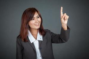 Asian business woman touching the screen and smile