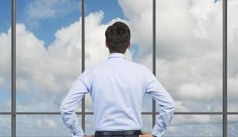 businessman looking to sky photo