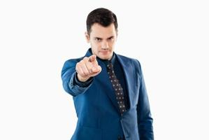 Businessman in office clothes pointing