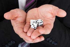 Business man holding dice