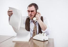 Vintage Silly Businessman Looking at Papers and Talking on Phone