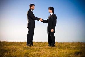 handshake business in the field photo
