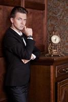 attractive young businessman in a suit, vintage interior