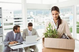 Businesswoman carrying her belongings in box photo