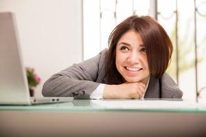 Happy business woman looking up photo