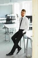 Portrait of Young Businessman Standing at his Office