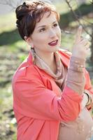 Beautiful young pregnant woman at spring outdoor photo