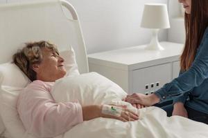 Girl caring about caring grandma