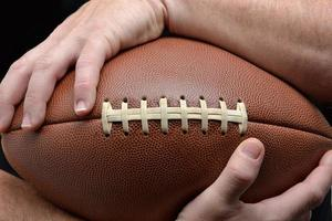 Holding Football